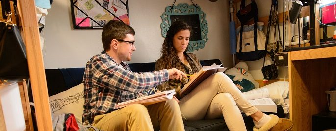 Male and Female student studying in residence hall room