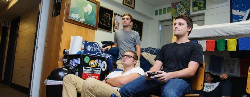 Male students in residence hall room