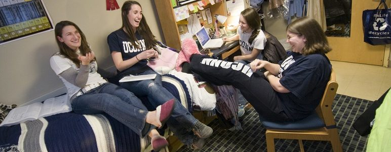 Four students studying in residence hall room