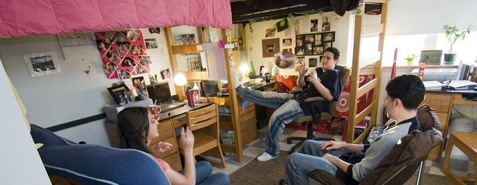 Students in their dorm rooms at Busby suites.