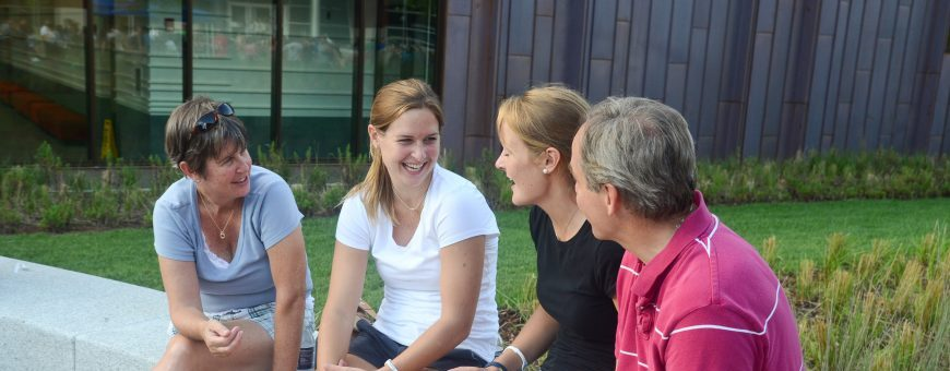Heather Grove '16 (CLAS), (black shirt), eats with her sister Caileigh (white shirt) and her parents during the Husky WOW Barbecue on Fairfield Way on August 26, 2011. (Ariel Dowski/UConn Photo)