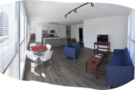 A panoramic viewe of a two bedroom, three student suite of new dormitory housing for students at the UConn Stamford campus on Aug. 16, 2017. (Peter Morenus/UConn Photo)