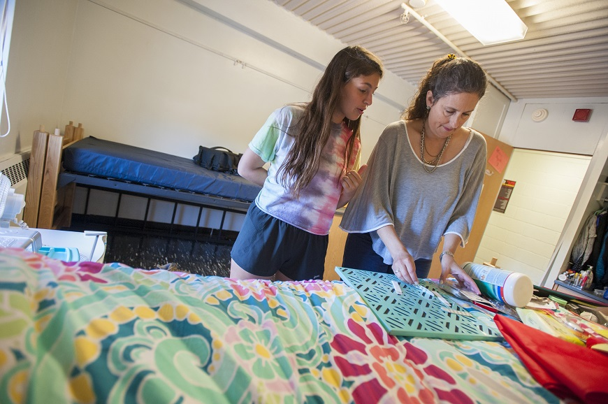 Mother and daughter unpack in residence hall room