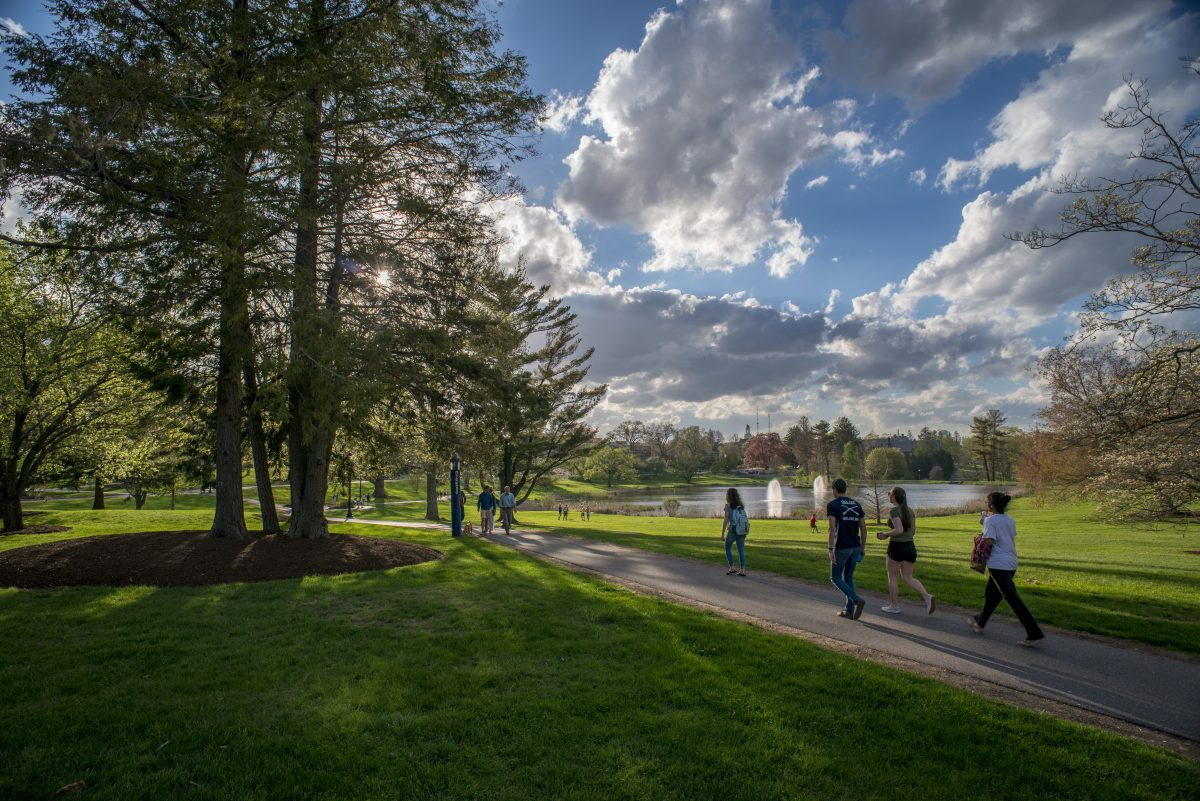 View of students walking down the pathway at Mirror Lake on May 2, 2017.