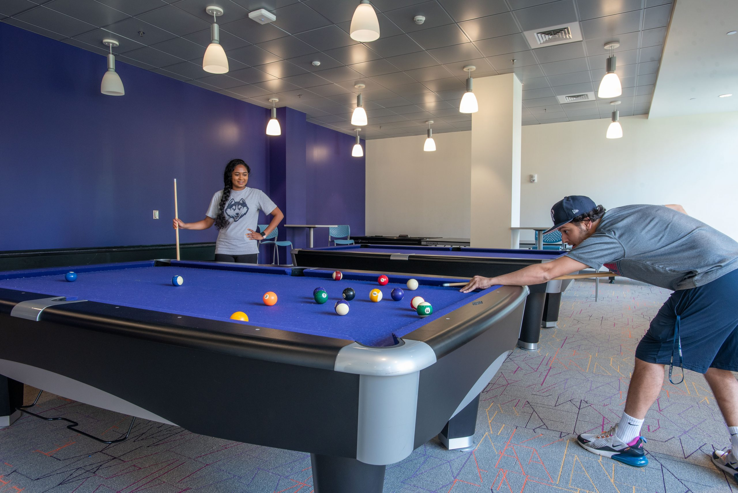 Werth Tower game room, two students playing pool